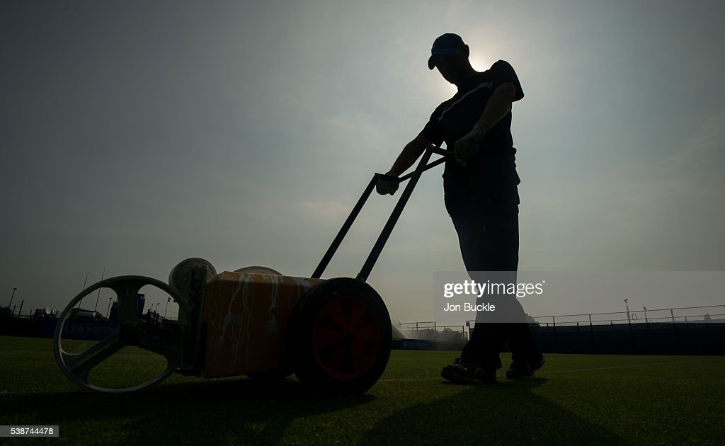 Member of the ground staff prepare the court ahead of play on day three of the WTA Aegon Open on June 8, 2016 in Nottingham, England.