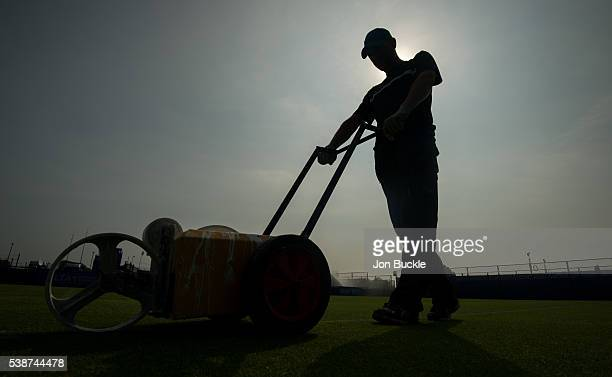 Member of the ground staff prepare the court ahead of play on day three of the WTA Aegon Open on June 8 2016 in Nottingham England