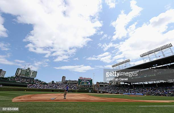 Member of the grounds crew grooms the infield before a game between the Chicago Cubs and the Pittsburgh Pirates at Wrigley Field on May 15, 2016 in...