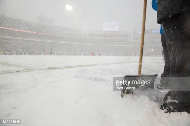 A member of the grounds crew holds a shovel on the sideline during the first quarter of the game between the Buffalo Bills and the Indianapolis Colts...