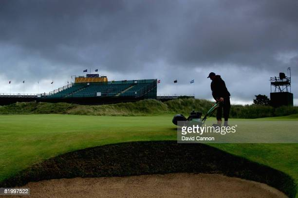 A member of the grounds staff mows a green during the third round of the 137th Open Championship on July 19 2008 at Royal Birkdale Golf Club...