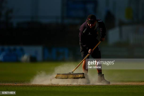 A member of the groundstaff makes repairs to one of the creases after the Specsavers County Championship Division Two match between Sussex and...