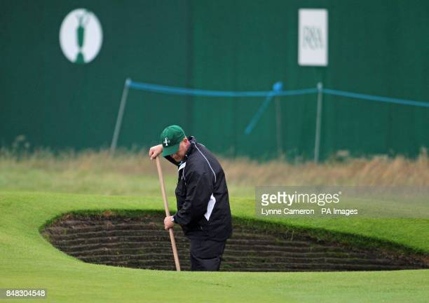 Member of the groundstaff sweeps a bunker during the fourth practice day for the 2012 Open Championship at Royal Lytham & St. Annes Golf Club, Lytham...