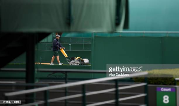 A member of the groundstaff works on a court at The All England Tennis and Croquet Club on June 29 2020 in Wimbledon England The Wimbledon Tennis...
