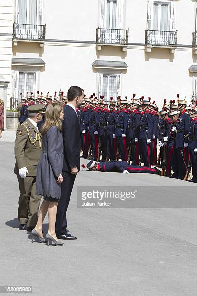 A Member Of The Guard Honour Faints Shortly Before The Arrival Of The Prince Of Wales And Duchess Of Cornwall Watched By Crown Prince Felipe And...