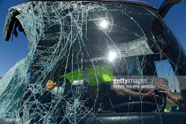 A member of the Guardia Civil inspects a damaged bus after it crashed on the N403 road near Avila on July 8 2013 A bus careened off a central Spanish...