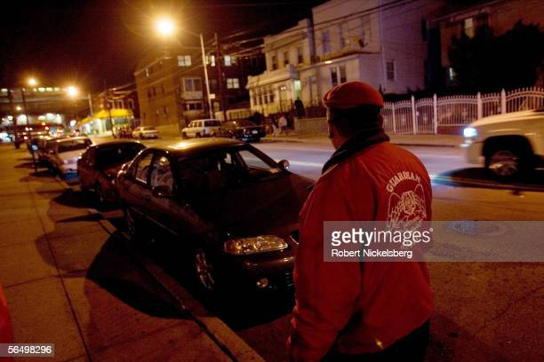 A member of the Guardian Angels a volunteer civil service organization checks out the 'headquarters' of the street gang Mara Salvatrucha 13 a white...