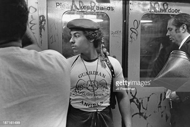 A member of the 'Guardian Angels' keeps watch on a New York subway train New York City 1980