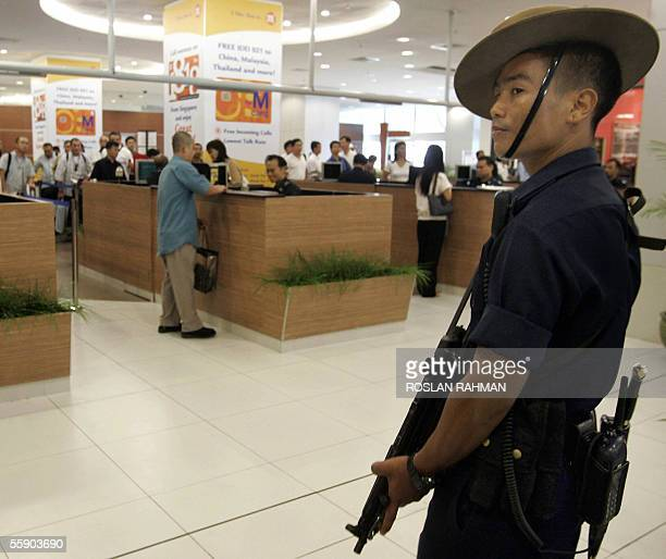 A member of the Gurkha contingent elite Nepalese fighters who gained fame in the British armed forces stands on alert at the International Cruise...