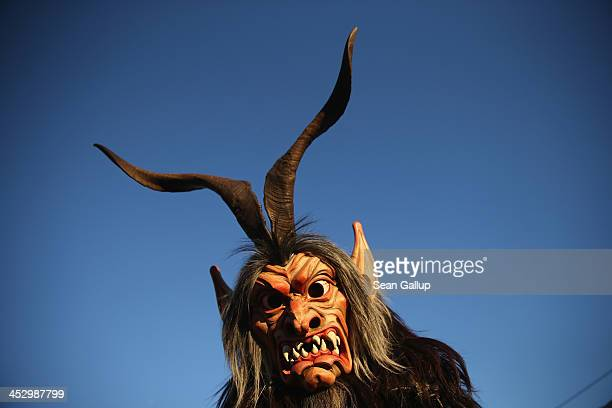 Member of the Haiminger Krampusgruppe dressed as the Krampus creature arrives prior to the annual Krampus night in Tyrol on December 1, 2013 in...