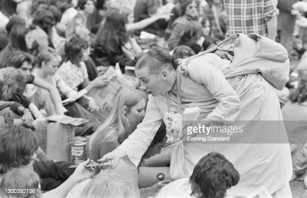 Member of the Hare Krishna movement selling 'joss sticks' or incense sticks at the Crystal Palace Garden Party 4, an outdoor concert at the Crystal...