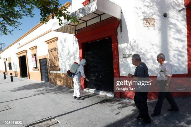 Member of the health personnel sanitizes the public spaces in Zapopan as part of the preventive measures against the spread of the COVID-19 on March...