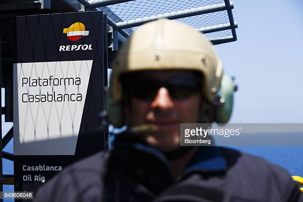 A member of the helicopter flight crew stands aboard the Casablanca oil platform operated by Repsol SA in the Mediterranean Sea off the coast of...