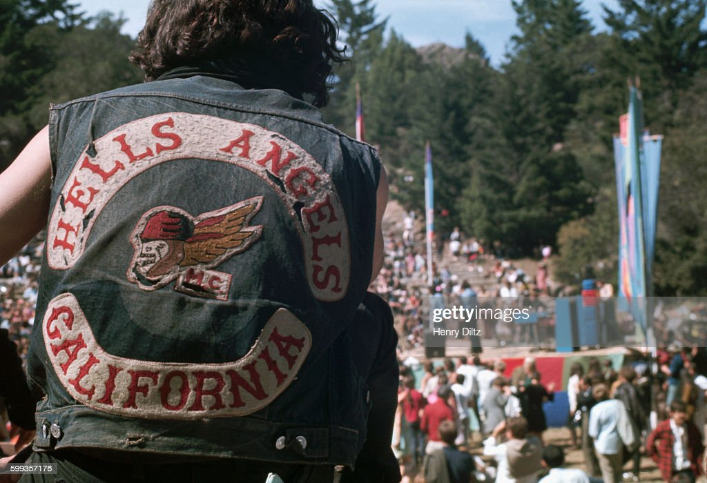A member of the Hell's Angels motorcycle gang watches the crowd at the Magic Mountain Music Festival, a 1967 concert on Mount Tamalpais featuring the Byrds and other rock bands.