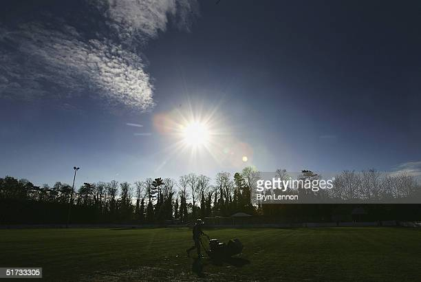 A member of the Histon FC groundstaff prepares the pitch for the FA Cup match between Histon FC and Shrewsbury Town at The Bridge on November 12 2004...