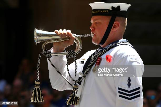 A member of the HMAS Waterhen and Royal Australian Navy Band plays The Last Post during the Remembrance Day Service held at the Cenotaph Martin Place...