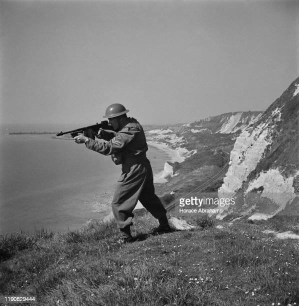 A member of the Home Guard on duty on the chalk cliffs of Dover in Kent England during World War II June 1941