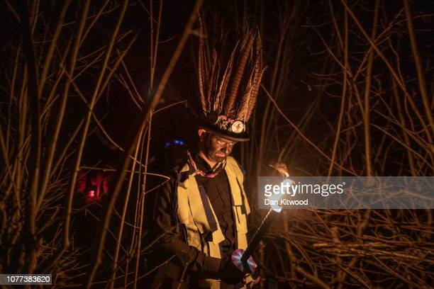 A member of the Hook Eagle Morris Men leads villagers to an orchard to 'Wassail' on January 4 2019 in Hartley Wintney England In this ancient ritual...