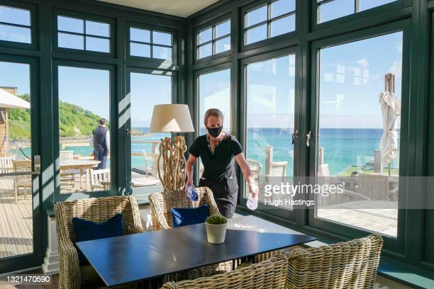 Member of the hotel staff cleans tables in the new orangery at the Carbis Bay Hotel, host venue for the G7 Summit conferences, on June 03, 2021 in...