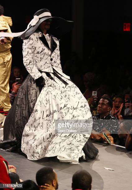 Member of the House of LaBeija competes in the category Butch Queen Runway Hector Xtravaganza Interpretation of the Billy Porter tuxedo gown at the...