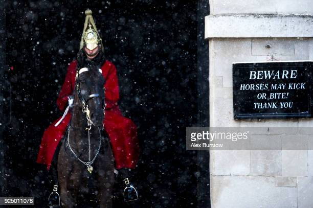 Member of the Household Cavalry is seen on guard at Horse Guard's Parade as snow falls on February 27, 2018 in London, United Kingdom. Freezing...