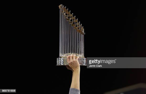 A member of the Houston Astros holds the Commissioner's Trophy after defeating the Los Angeles Dodgers 51 in game seven to win the 2017 World Series...