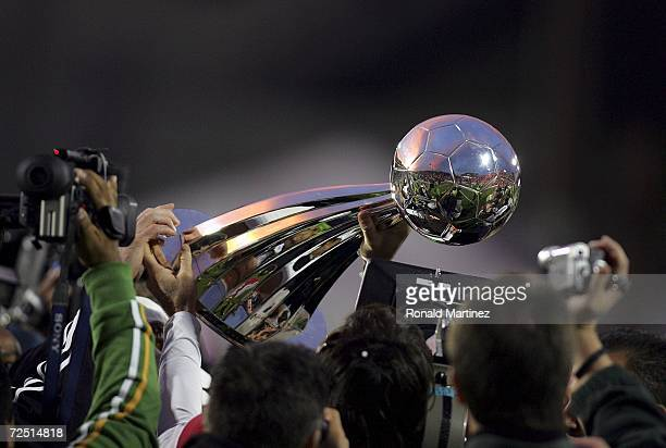 Member of the Houston Dynamo hoists the Alan I. Rothenberg Trophy after winning MLS Cup 2006 against the New England Revolution in penalty kicks 4-3...