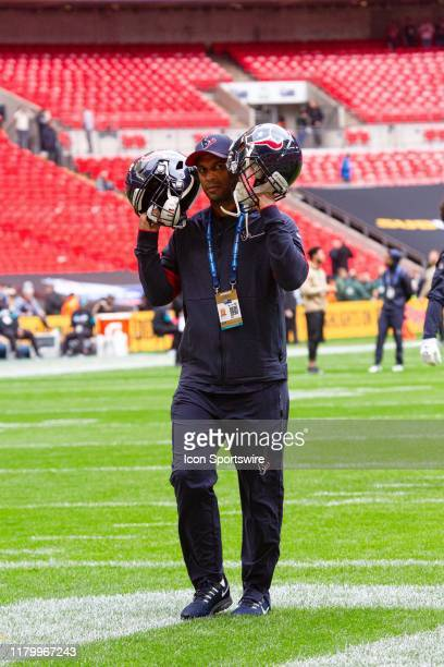 A member of the Houston Texans crew checks headset reception on the field before the NFL game between the Houston Texans and the Jacksonville Jaguars...