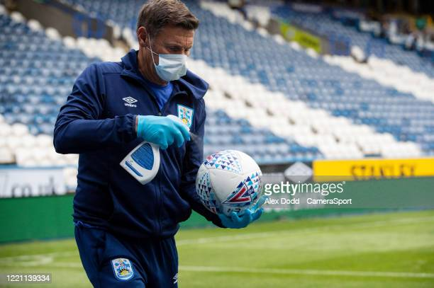 Member of the Huddersfield Town team cleans match balls during the Sky Bet Championship match between Huddersfield Town and Wigan Athletic at John...