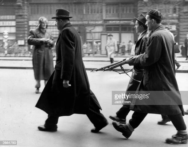 A member of the Hungarian secret police is marched off for questioning by patriots following the anticommunist uprising The revolt ended with the...
