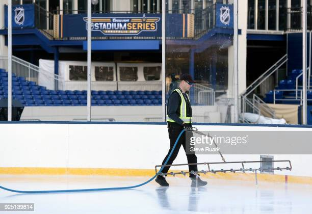 A member of the ice crew helps prepare NavyMarine Corps Memorial Stadium for the 2018 Coors Light NHL Stadium Series game on February 27 2018 in...