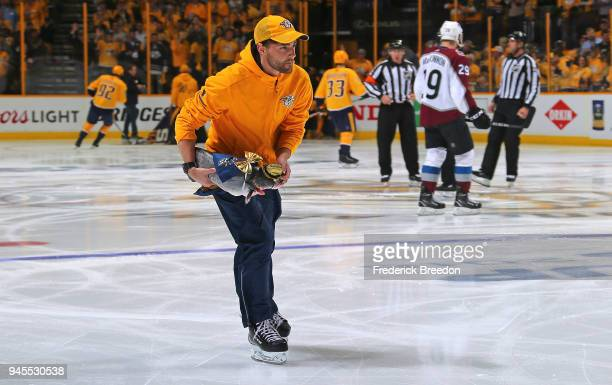 A member of the ice crew removes a catfish prior to the first period between the Nashville Predators and the Colorado Avalanche in Game One of the...