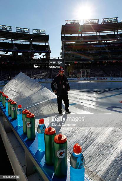 A member of the ice crew stands on the the ice surface cover during practice day prior to the 2015 Bridgestone NHL Winter Classic on December 31 2014...
