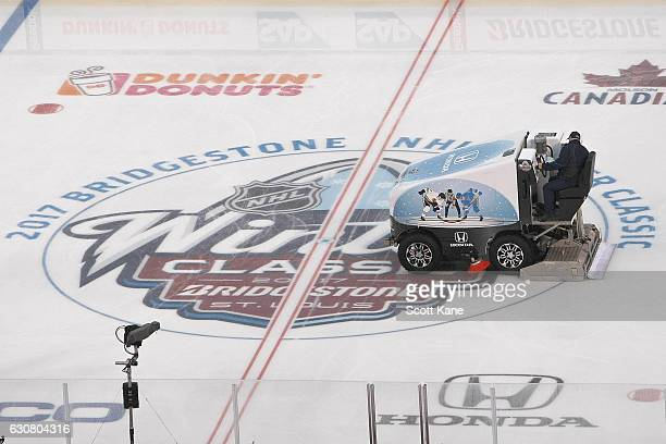 A member of the ice crews prepares the ice prior to the start of the 2017 Bridgestone NHL Winter Classic between the St Louis Blues and the Chicago...