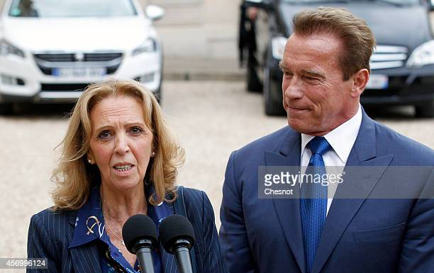 Member of the Ile-de-France regional council Michele Sabban makes a statement next to former governor of California and founding chair of the R20...