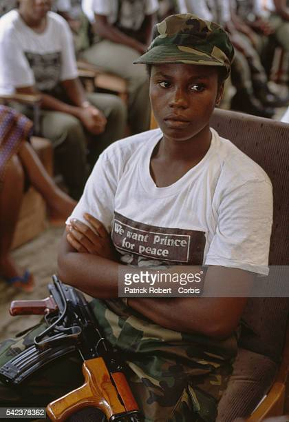 A member of the Independent National Patriotic Front of Liberia a militant group lead by Prince Yormie Johnson wears a tshirt reading We want Prince...