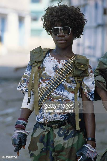 A member of the Independent National Patriotic Front of Liberia dresses himself in a wig an act often done by rebel forces for spiritualistic reasons...