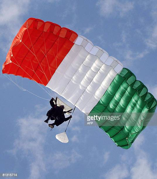 A member of the Indian Air Force's 'Akash Ganga' skydiving team lands during the Diamond Jubilee celebrations of the Srinagar Air Force Station in...