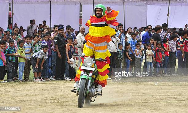 A member of the Indian Army performs on a motorbike during an Army show in Allahabad on April 20 2013 India hiked its defence spending by only five...