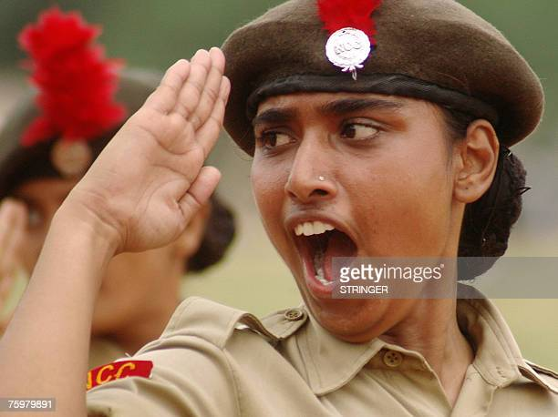 A member of the Indian National Cadet Corps Divya Tiwari salutes during the march past at a rehearsal for Independence Day celebrations at the Parade...