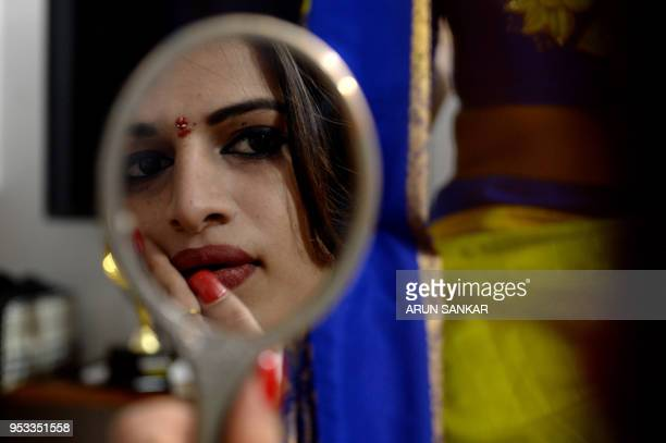 TOPSHOT A member of the Indian transgender community prepares to travel to a festival at the Koothandavar Temple in the village of Koovagam in the...