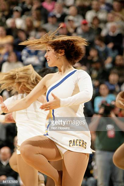 A member of the Indiana Pacers Pacemates performs during a timeout as the Pacers took on the New Orleans Hornets at Conseco Fieldhouse on December 28...
