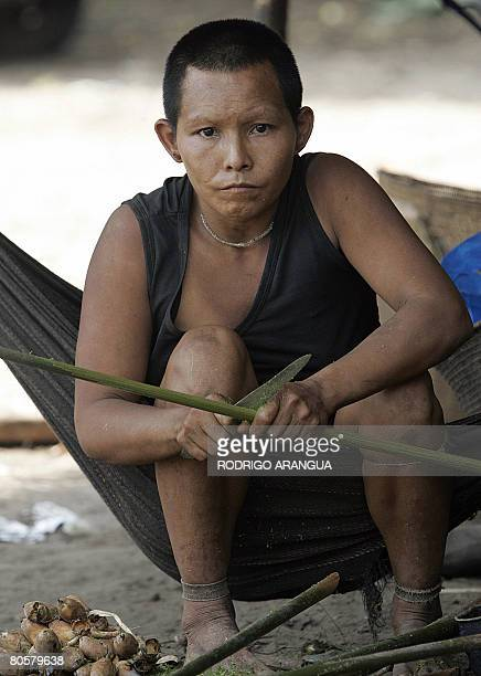 Member of the indigenous Nukak-Maku ethnic group, the last nomadic people of Colombia, makes a spear on April 7 in a provisional settlement in Agua...