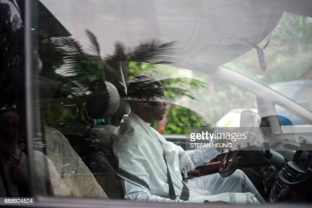 A member of the Indigenous People of Biafra militants and members of the Yahveh Yashua Synagogue arrives to the Shabbat celebrations outside the...
