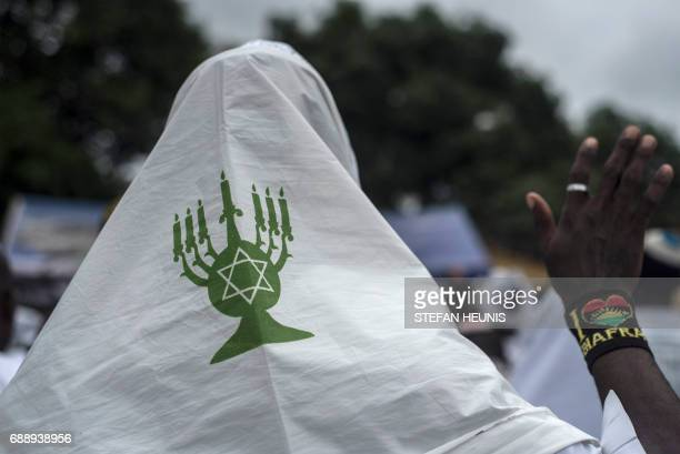 A member of the Indigenous People of Biafra militants and of the Yahveh Yashua Synagogue celebrates Shabbat outside the house of the movements leader...