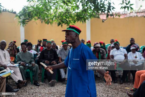 A member of the Indigenous People of Biafra movement sings and dances during a meeting between political activist and leader of the Indigenous People...