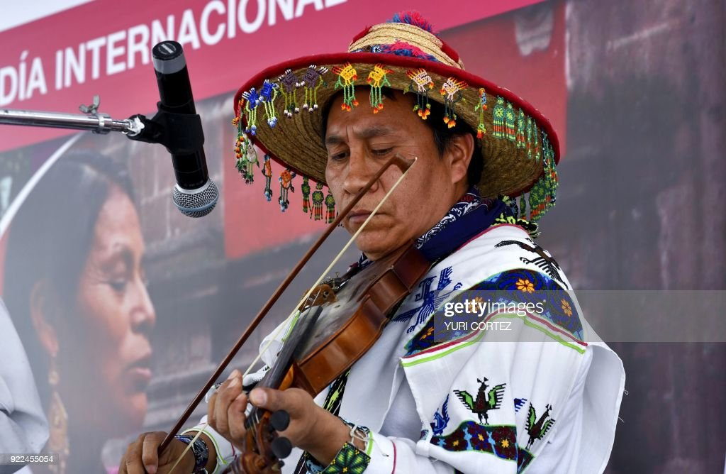 A member of the indigenous Wixarika community plays the violin during a concert presented to mark the International Day of the Mother Tongue in Mexico City, during the 'in the heart of Mexico festival', on February 21, 2018. Representatives of all Mexican states present samples of their food, clothing and traditions during the festival. /
