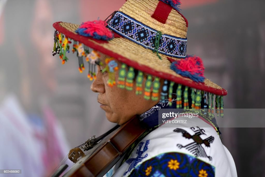 A member of the indigenous Wixarika community plays the violin during a concert presented to mark the International Day of the Mother Tongue in Mexico City, during the 'in the heart of Mexico festi...