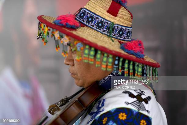 A member of the indigenous Wixarika community plays the violin during a concert presented to mark the International Day of the Mother Tongue in...