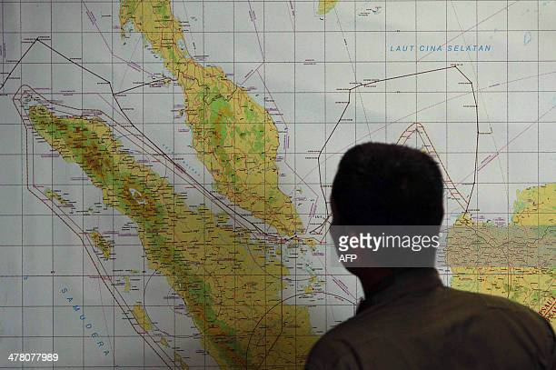 A member of the Indonesian Air Force at Medan city military base inspects the Indonesian military search operation for the missing Malaysian Airlines...